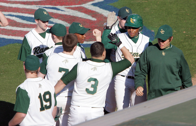 Classical's Eddie Terrero is congratulated by teammates after scoring against Georgetown at Fraser Field Wednesday April 14, 2010. Item Photo/ Reba M. Saldanha