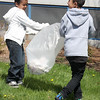 Clean up day at the Callahan School in Lynn. Dinh Duong, left, and Tayler Vargas work at the front of the school.
