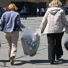 Clean up day at the Callahan School in Lynn. Mary Williams, left, and Elaine Lally haul the take to the dumpster.