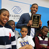Youth of the Year Nehemie Alcindor poses with his plaque and fellow Boys and Girls CLub members (from left) Dominic Jette, Ishmile Bangura, Jayden Lowe, Terrance Valantine, and Alicia Thomas during their annual awards banquet at thei Lynn facility Wednesday April 14, 2010. Item Photo/ Reba M. Saldanha