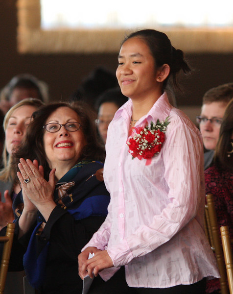 Girl Hero Phumana Phim heads to the stage during the 22nd annual Girl's Inc. luncheon at the Danvers Port Yacht Club.