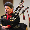 Fantasy author Julie Hahnke ended her talk to the students at Lynn English by playing the bagpipes.