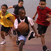 Mohamed Nadiaye breaks away from his opponents during a pick up game of basketball at the YMCA on Saturday.