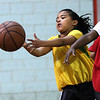 Idalis Lora grabs a rebound during a pickup game of basketball at the 10th annual Healthy Kids Day at the YMCA in Lynn on Saturday.