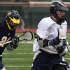 Matt Molloy,4, of Saint Mary's carries the ball down field in a game against Arlington Catholic at Manning Field.