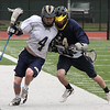 Matt Molloy, 4, Saint Mary's, is checked by an opponent from Arlington Catholic in a game at Manning Field on Saturday. Final score: S. Mary's 5, Arlington Catholic 14.