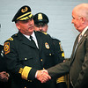 Nahant Chief of Police Robert Dwyer shakes the hand of former chief William Waters during his swearing in at Town Hall Thursday April 1, 2010. Item Photo/ Reba M. Saldanha
