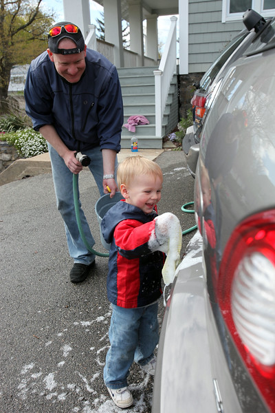 Will Bochnak, 2, helps father Bill wash their family cars in their Lynn driveway Monday April 19, 2010. Item Photo/ Reba M. Saldanha