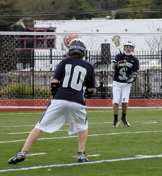 Swampscott's Patrick Kennedy passes to teammate Aiden Lang at Fraser Field Tuesday April 20, 2010. Item Photo/ Reba M. Saldanha