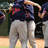 John DiVenuti hugs Paul Norton after he crossed home plate in today's game against Lynn Classical.
