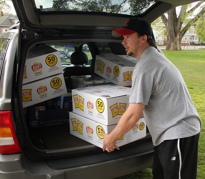 Ryan Boisselle gets the snack bar at Volunteer Field in Lynn ready for Little League opening day tomorrow. Volunteer Field will start their parade in front of English High at 8:30 tomorrow, Pine Hill will begin their parade at 9:30 and West Lynn American will start their parade at 10.