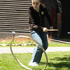 Michelle Shabarek plays with a colonial game called stick and hoop at the Saugus Iron Works on Saturday.