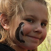 Paige Boyer had a penguin painted on her face and then went out to pick up trash at Breakheart Reservation as part of Park Service Day on Saturday.