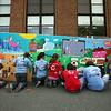 Volunteers paint a mural during the J-Serve public space improvement program at the Ford School Sunday April 25, 2010. Item Photo/ Reba M. Saldanha