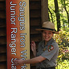Liz Sampson hangs the new sign on the new Jr. Ranger Station in the Saugus Iron Works on Saturday.