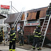 Firefighters secure the scene at the corner of Western Ave and Washington Street where Angelina's sub shop caught fire Sunday afternoon. Item Photo/ Reba M. Saldanha