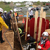 Members of the Essex County Technical Rescue Team held a mock trench collapse rescue at Brooksby Farm today. They used a T-Trench because it is  both the most difficult trench to shore up and the most difficult trench to save a victim from. The operations begins with the rescuers fortifying the sides of the trench. This task could take between 4 and 6 hours if the victim is buried waist deep in dirt and upwards of eight hours of the victim is buried up to the neck.