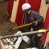 Jeff Siriors, Beverly Fire, rakes dirt off of the victim in the T-trench during the mock trench collapse rescue at Brooksby Farm in Peabody.