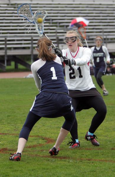 Swampscott's Elise Giangregorio and Salem's Rachel Disick battle it out at Salem's Bertram Field Tuesday April 27, 2010. Item Photo/ Reba M. Saldanha