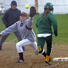 Lynn Classical's Angela Ereli and Lynn English's first baseman battle it out at Keaney Park in Lynn Wednesday April 28, 2010.  Item Photo/ Reba M. Saldanha
