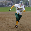 Lynn Classical's Hannah Byrne races the ball to third base at Keaney Park in Lynn Wednesday April 28, 2010.  Item Photo/ Reba M. Saldanha