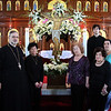 St.George Church in Lynn. Good Friday. From left to right: Father George Tsoukalas, Joanna Katsos, Nancy Bitopoulos, Olympia Manos, Regina DeFuria, and George Fabrikarakis prepare to celebrate Good Friday.