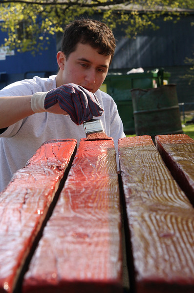 Greg Franzblau, General Electric volunteer,  painting a picnic bench at Gallagher Park today
