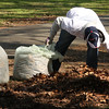 General Electric volunteer Alek Kanevsky cleaning up Gallagher park in Lynn today.