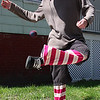 Mat Stevens enjoys the day by playing Hacky Sack in front of his house on Chestnut Street in Lynn today.
