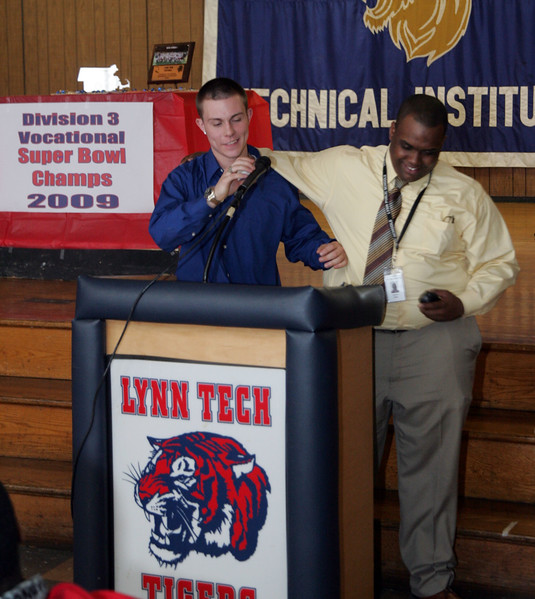 Coach Angel DeLeon and player Dunstin Rooney at the Lynn Tech Superbowl Ring ceremony celebrating the 2009 Division 4 Vocational State Championship at Lynn Tech Thursday April 29, 2010. Item Photo/ Reba M. Saldanha
