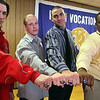 Captains (from left) Joe Brady, Stephen Caisse and Ryan Murphy pose with coach Angel DeLeon and their rings at the Lynn Tech Superbowl Ring ceremony celebrating the 2009 Division 4 Vocational State Championship at Lynn Tech Thursday April 29, 2010. Item Photo/ Reba M. Saldanha
