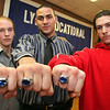 Captains (from left) Stephen Caisse, Ryan Murphy, and Joe Brady pose with their rings at the Lynn Tech Superbowl Ring ceremony celebrating the 2009 Division 4 Vocational State Championship at Lynn Tech Thursday April 29, 2010. Item Photo/ Reba M. Saldanha