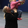 Kari Penny and her daughter Skye Penny shooting baskets in the Lynn Tech field house. Skye is 28 months old and is already watching basketball.