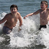Jonathan LeBlanc, left, and Jared Waite take their first dip of the season at Red Rock on Saturday.