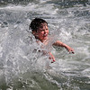 Jared Waite takes his first dip of the season at Red Rock on Saturday.