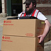 Chris Robarge carries two packages for Patti Difonzo.