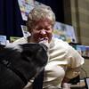 Principal Michael Molnar kisses Daisy the Pig during the reading challenge with Farmer Minor at Harrington Elementary School on Monday April 5, 2010. Item Photo/ Reba M. Saldanha