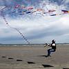 Paul Lawrence of Peabody kite buggies on Nahant's long beach Monday April 5, 2010. Item Photo/ Reba M. Saldanha