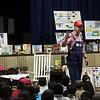 Farmer Minor addresses reading challenge students at Harrington Elementary School as Daisy the Pig looks on Monday April 5, 2010. Item Photo/ Reba M. Saldanha