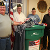Saugus American Legion members (from left) Commander Rich Milligan, Past Commander Doug Cooper, Eboard Chair Jack Klecker and Bill Diotte pose with a container for recylcing flags during their meeting Tuesday April 6, 2010. Item Photo/ Reba M. Saldanha
