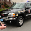 Harold Young, the Saugus K-9 officer, with his new truck, a 2007 GMC.