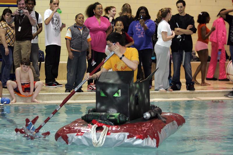 Classmates watchLynn English High School junior Christian Peralta test the buoyancy of their rafts at the Lynn YMCA on Thursday April 8, 2010.  Item Photo/ Reba M. Saldanha.