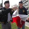 Mitchell Ramonas, left and Stanley Danisisewicz, right  along with Mayor Kennedy,raise the Polish flag in City Hall Square today.