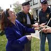 Mayor Kennedy helps Mitchell Romonas, and Stanley Danisiewicz, right,