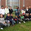 The fifth grade class at the Hood School in Lynn who won the Disney Challenge planting this tree.