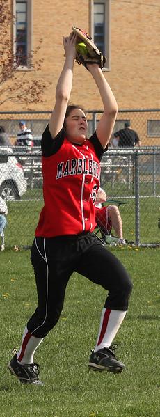 Katherine Digiammarino makes in field catch.