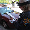 Colleen Fitzgerald writing a parking ticket in Lynn today.