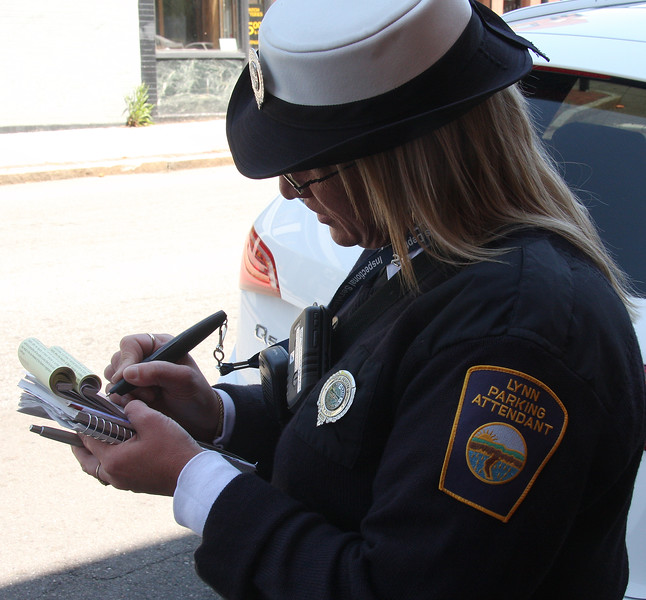 Colleen Fitzgerald writes a parking tickets in Lynn.