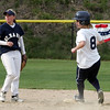 St Mary's Erin McAndrews and Swampscott's Alex Wilson checks the throw to second in Swampscott Tuesday May 11, 2010. Item Photo/ Reba M. Saldanha