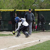 St Mary's Erin McAndrews crosses the plate as Swampscott's Moe Bradley scoops the ball in Swampscott Tuesday May 11, 2010. Item Photo/ Reba M. Saldanha